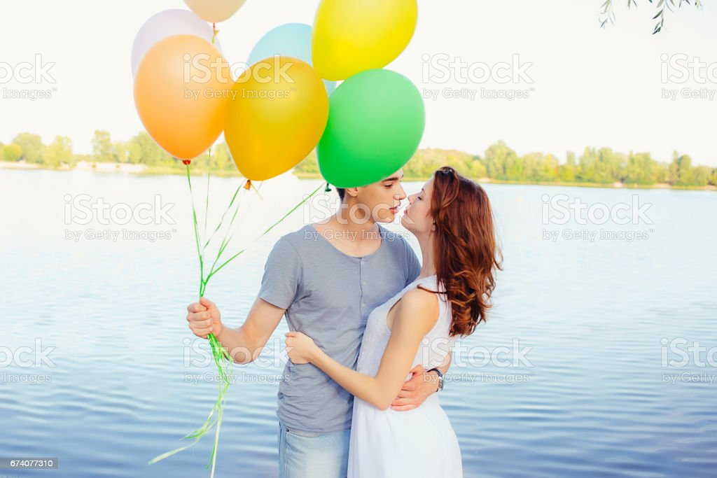 Lovely merry happy couple with balloons stock photo