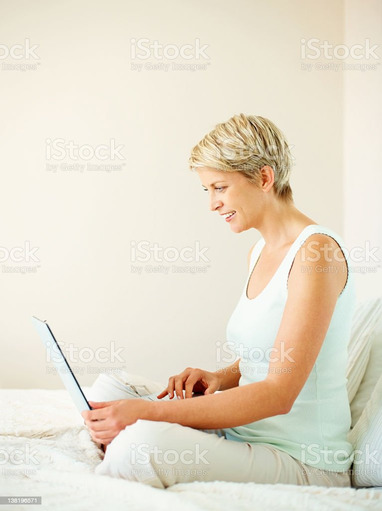 Lovely mid adult woman working on a laptop royalty-free stock photo