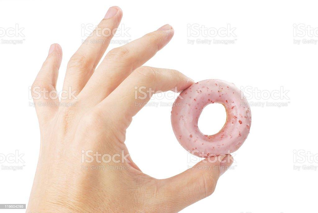 Lovely mini donut in man's hand royalty-free stock photo