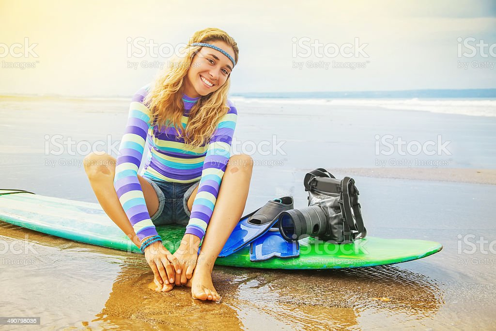 Lovely optimistic surf photographer girl stock photo