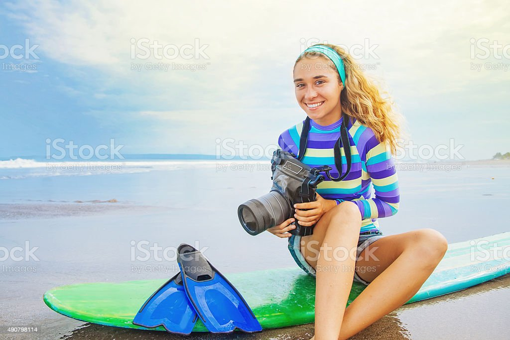 Lovely optimistic surf photographer girl stock photo