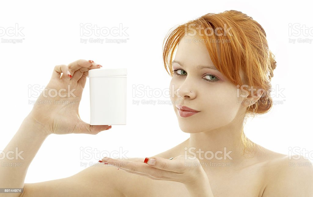 lovely redhead showing blank medication container royalty-free stock photo