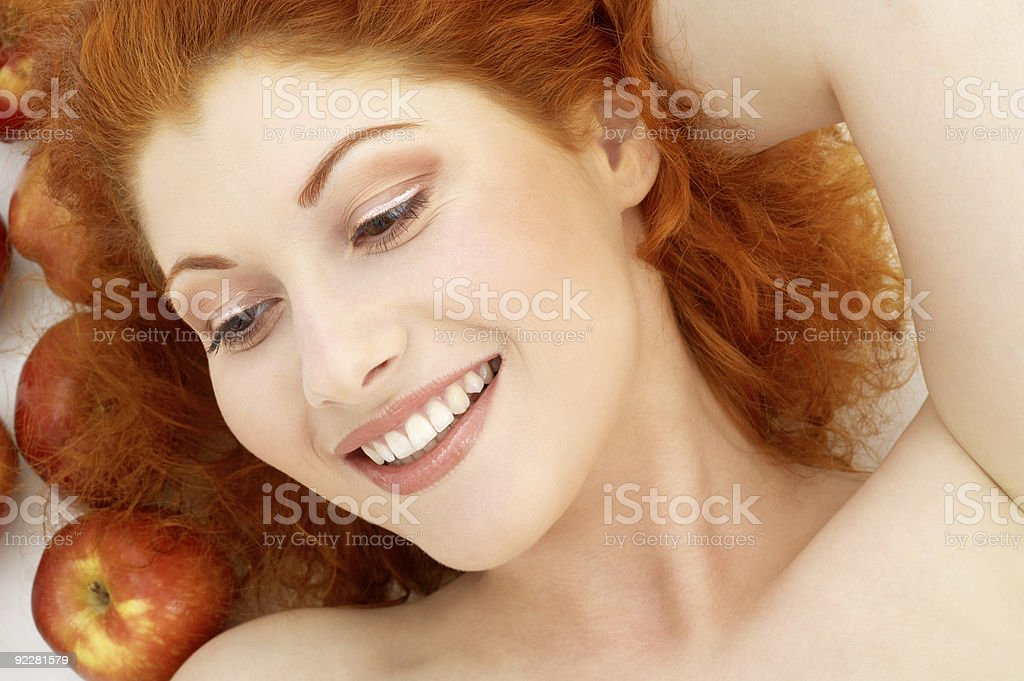 lovely redhead with red apples royalty-free stock photo