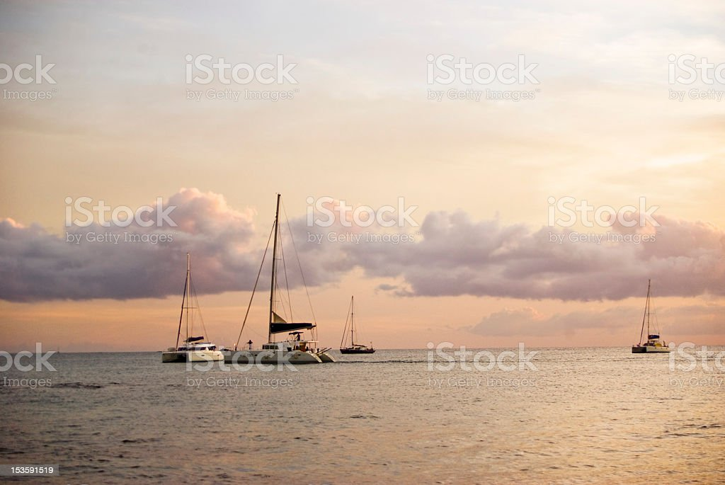 lovely sea and yachts at sunset stock photo