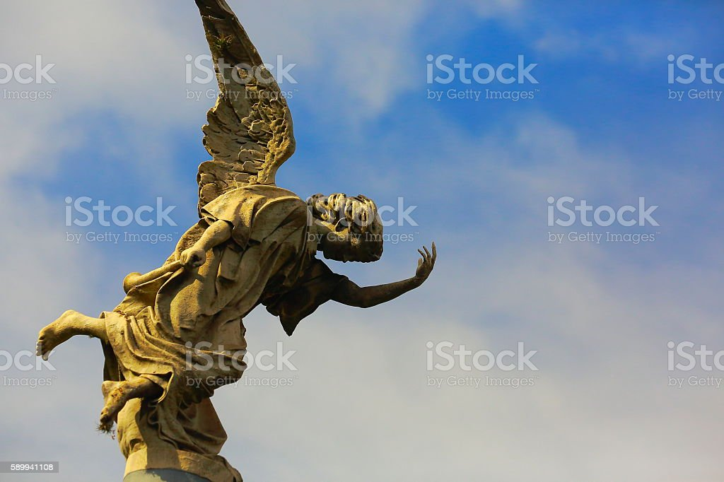 Lovely Seraphim Angel peaceful contemplation, gold sunset, Recoleta Cemetery stock photo
