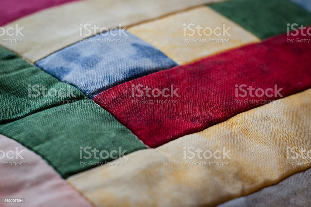 Lovely shot of pillow created by patchwork technique. Second. stock photo