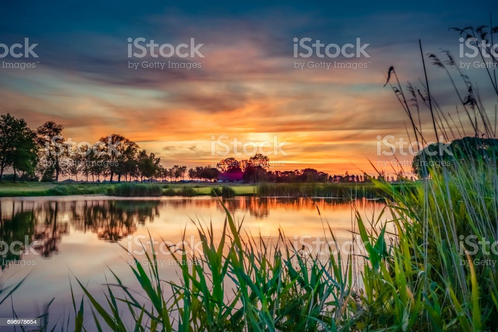 Lovely sunset in a typical Dutch landscape stock photo
