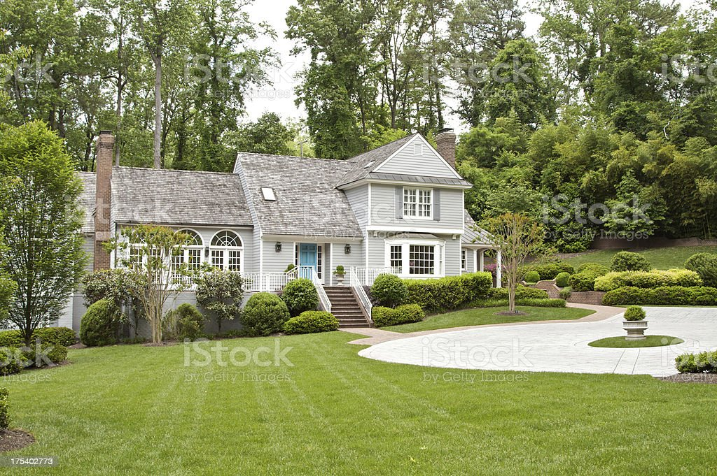 A lovely thatched back roof large suburban house stock photo