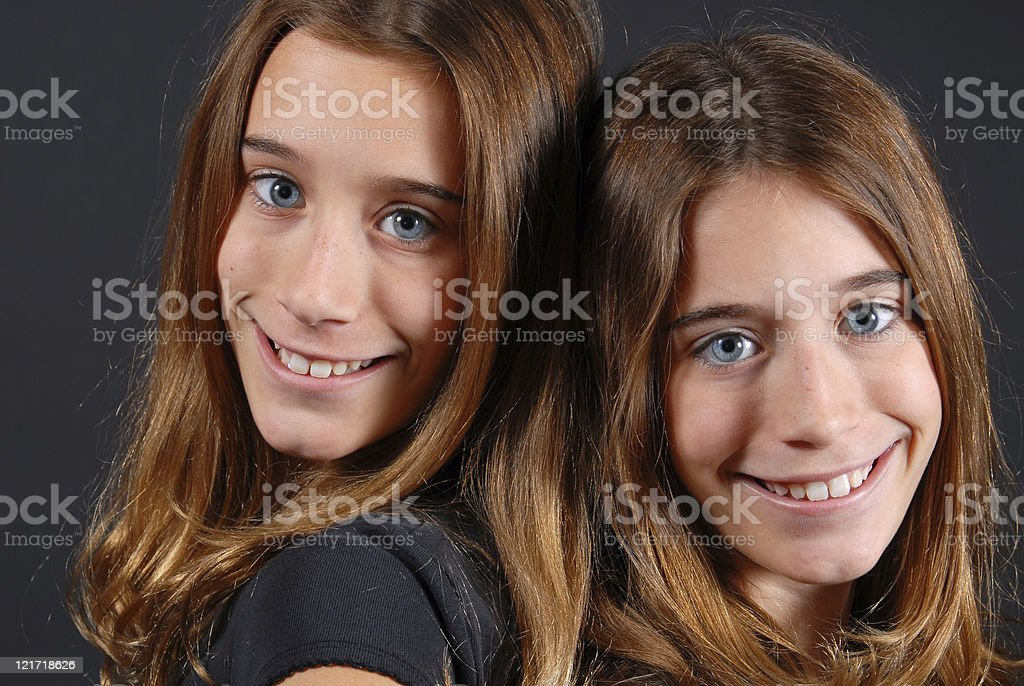 Lovely Twin Sisters stock photo