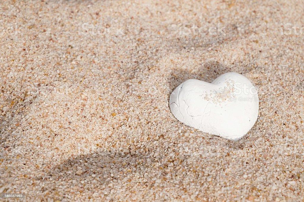Lovely white shell heart on sand royalty-free stock photo