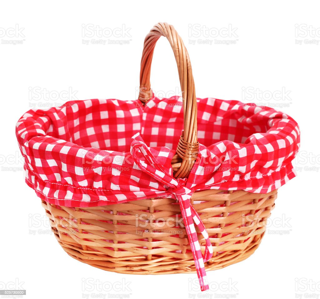 Lovely wicker basket with red white plaid lining stock photo