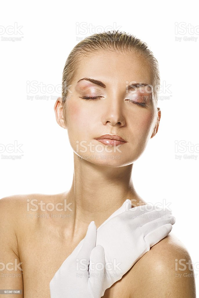 Lovely woman in moisturizing gloves royalty-free stock photo