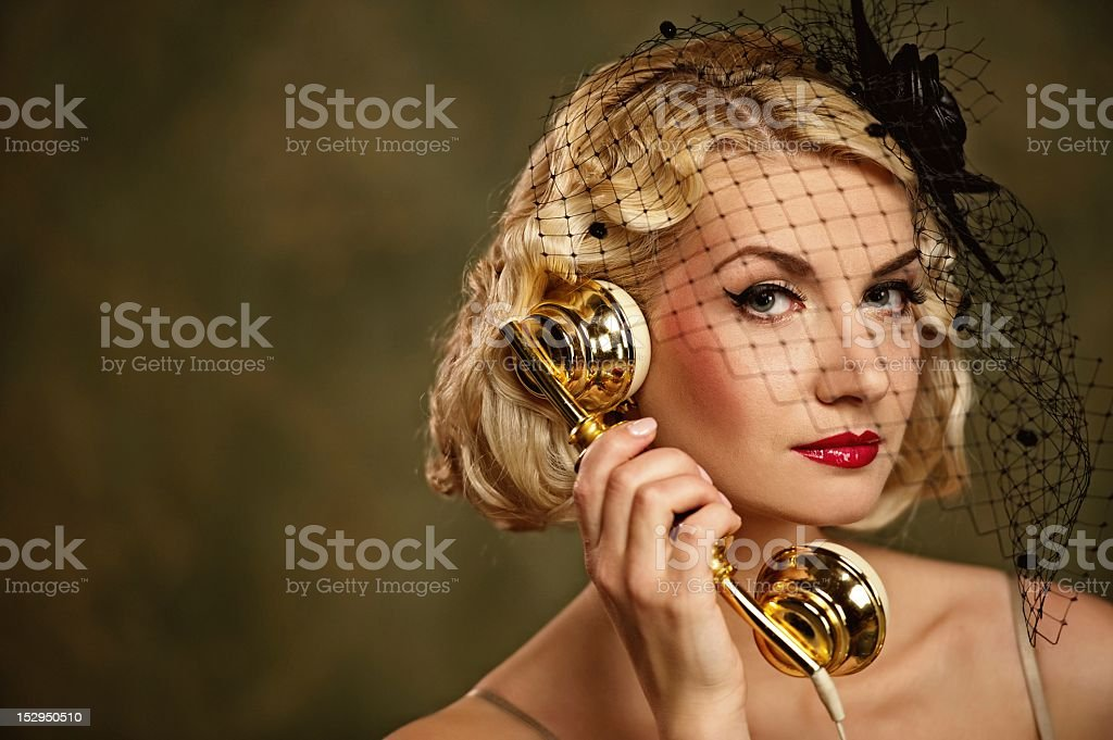 Lovely woman with a phone. Retro portrait royalty-free stock photo