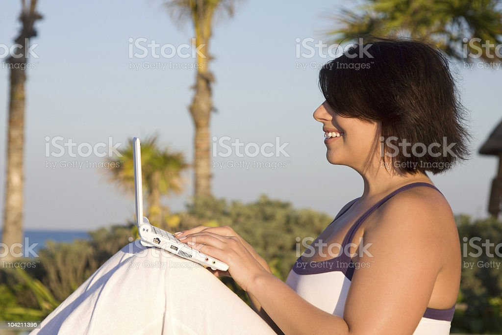 lovely woman with laptop computer royalty-free stock photo