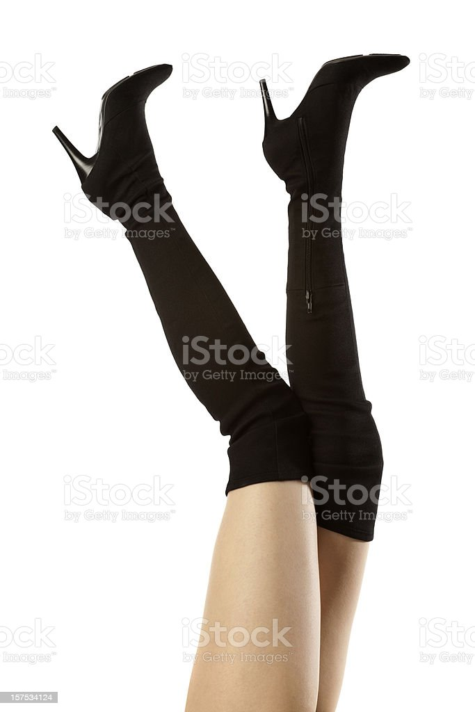 Lovely Woman's Long Legs, Killer Tall Black Spike Heel Boots stock photo