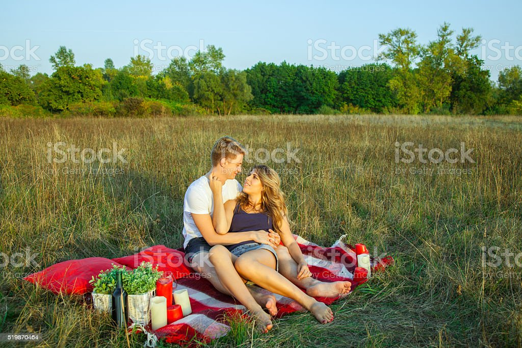 Lovely young beautiful couple resting in park stock photo