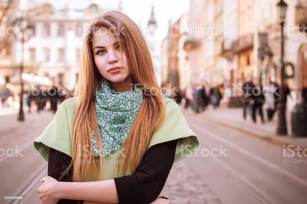 Lovely young  blonde woman in a coat stock photo