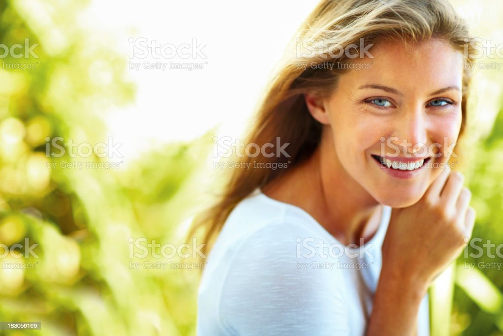 Lovely young female against a natural background stock photo