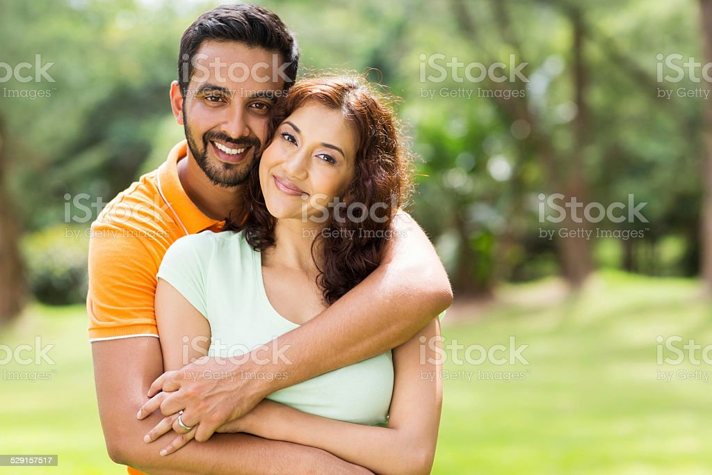 lovely young indian couple outdoors stock photo