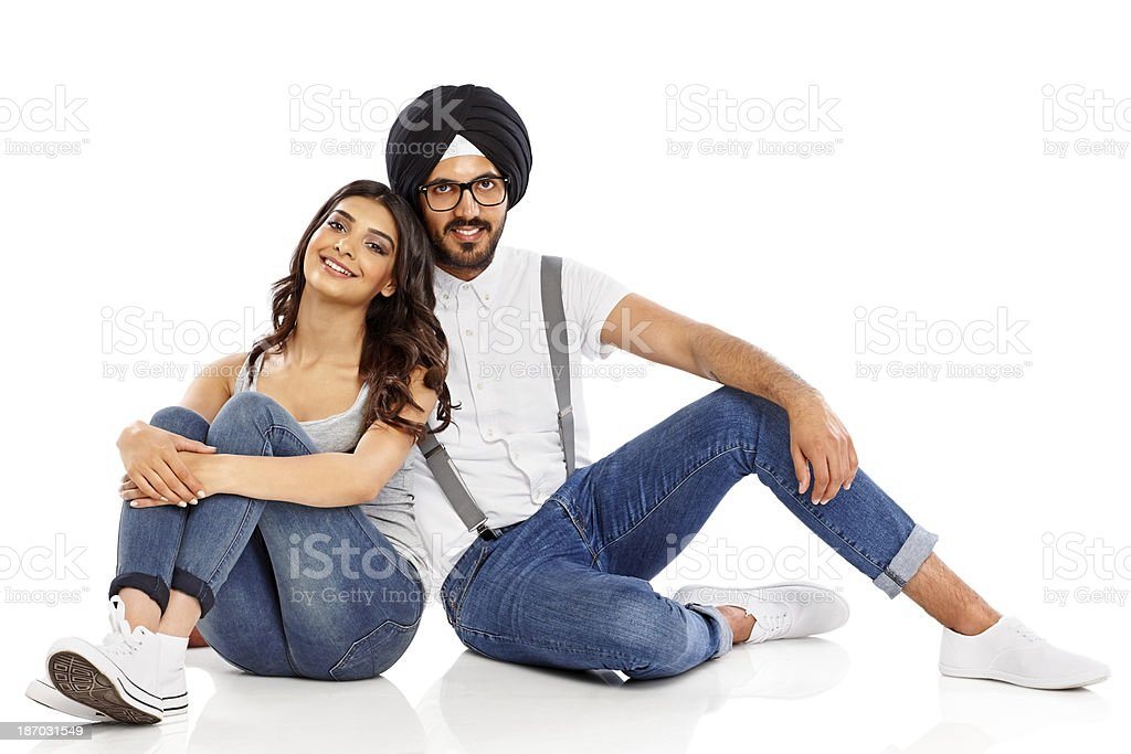 Lovely young Indian couple sitting together royalty-free stock photo