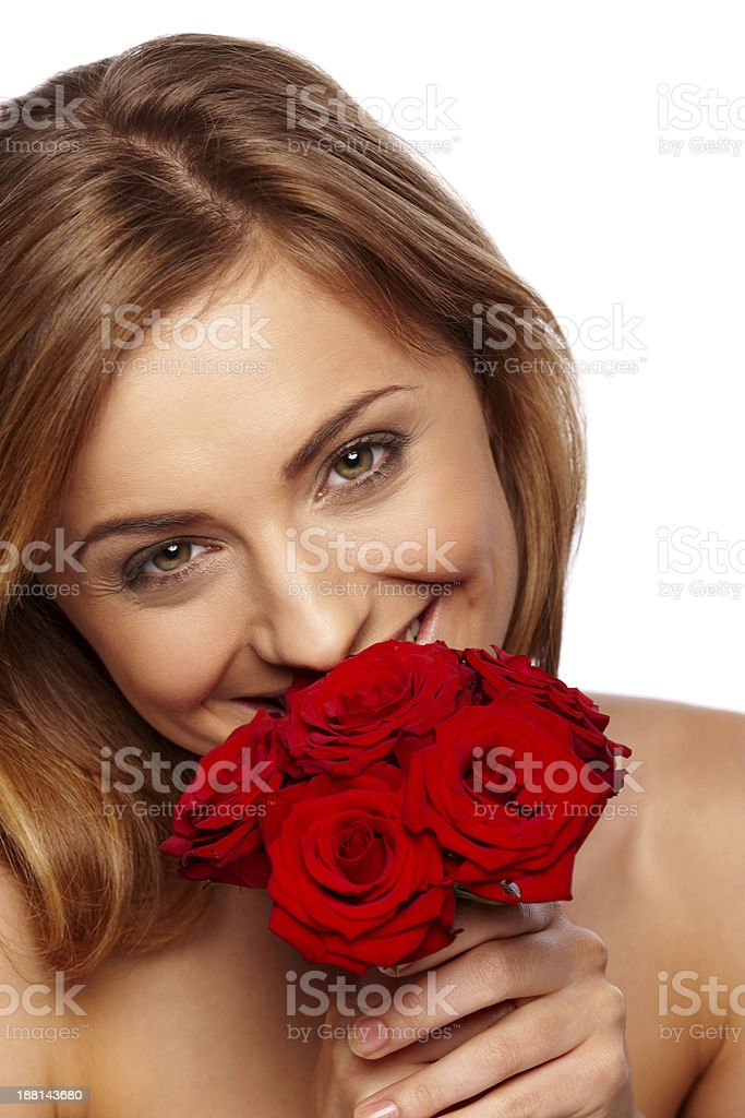 Lovely young lady smiling with roses royalty-free stock photo