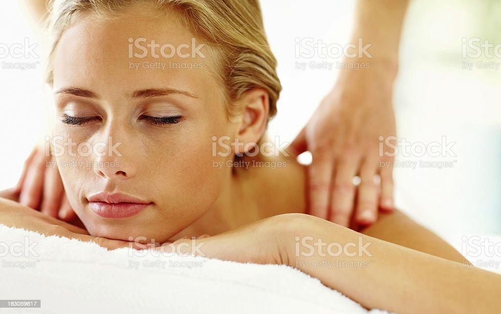 Lovely young woman relaxing during a body massage royalty-free stock photo