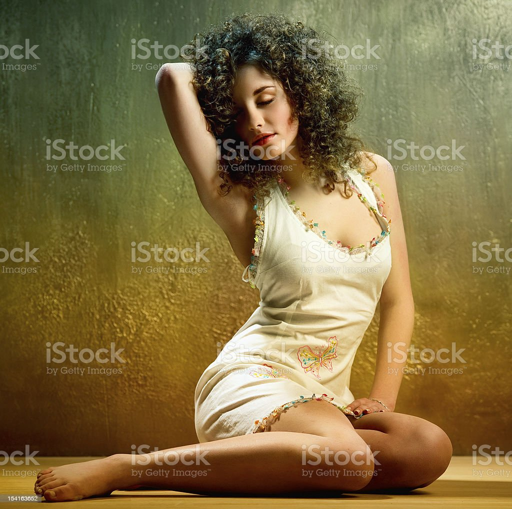 Lovely young woman with curly hair indoors royalty-free stock photo