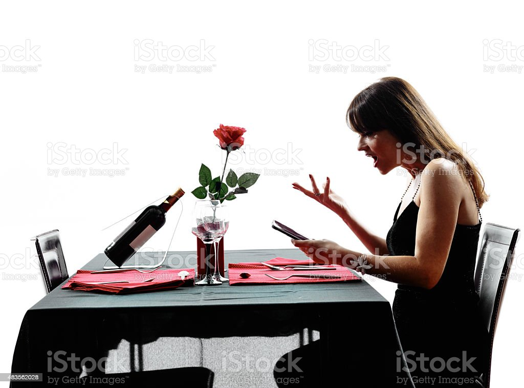 lover woman waiting for dinner silhouettes stock photo