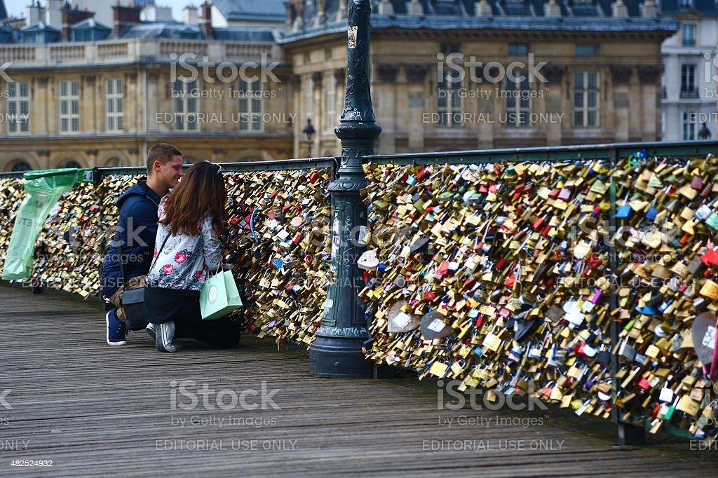 Lovers and padlocks on pont des arts, Paris stock photo