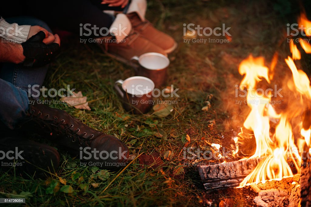 lovers around the campfire at night stock photo