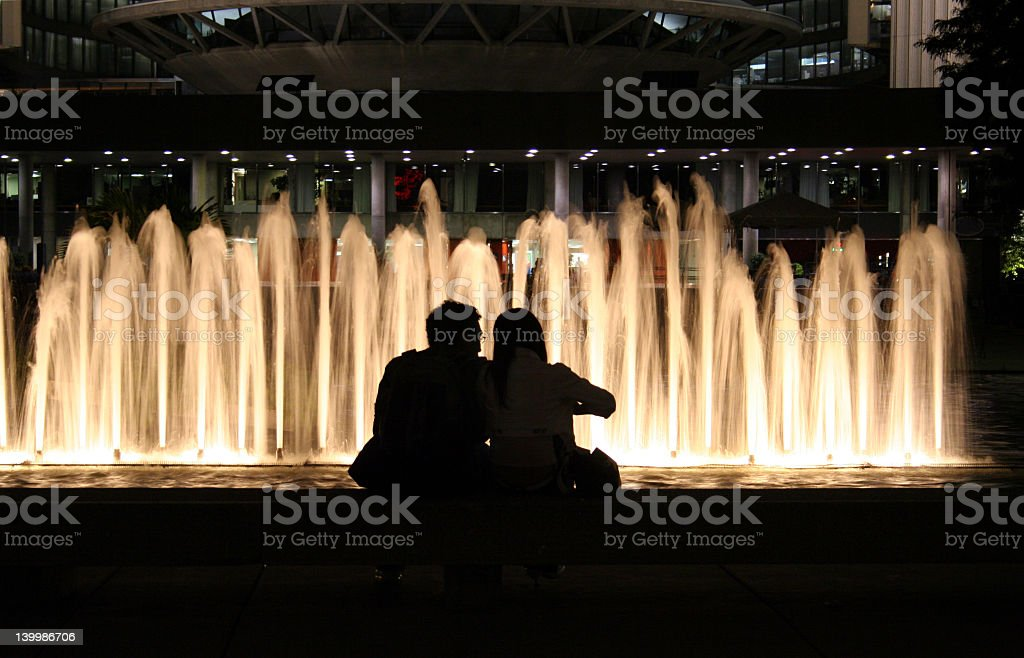 Lovers by a fountain royalty-free stock photo