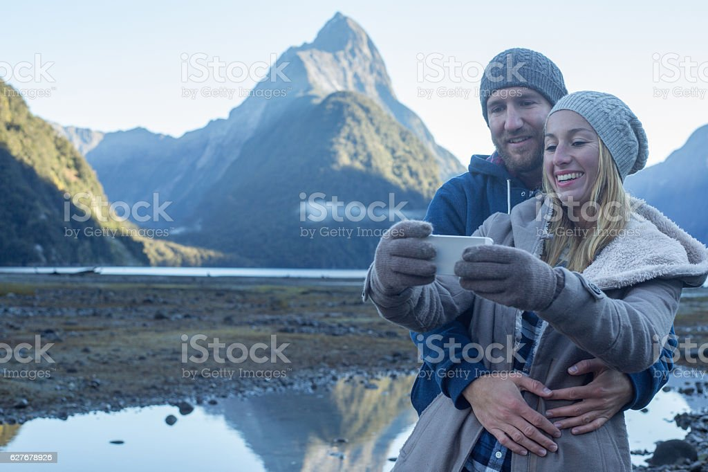 Lovers capture a selfie of romantic moment in remote nature stock photo