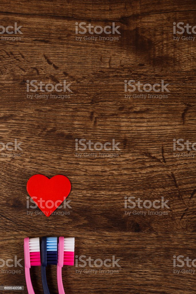Lovers concept with heart and toothbrushes. stock photo
