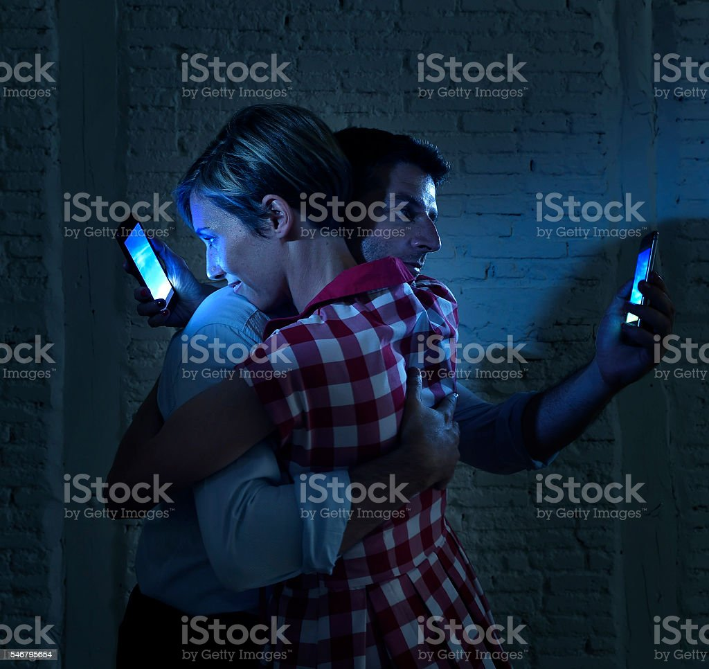 lovers couple of internet mobile phone addict ignoring each other stock photo