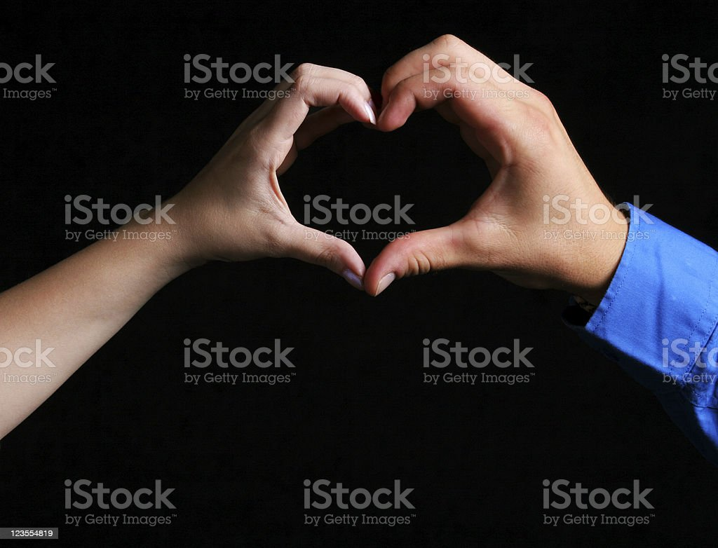 Lovers forming a heart shape royalty-free stock photo