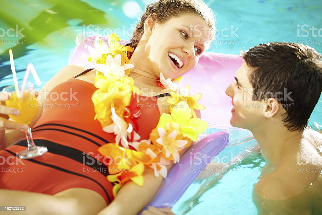 Lovers in pool royalty-free stock photo
