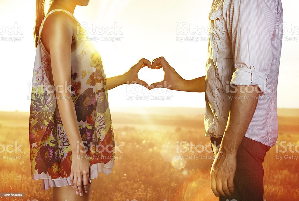 Lovers in sun beams stock photo