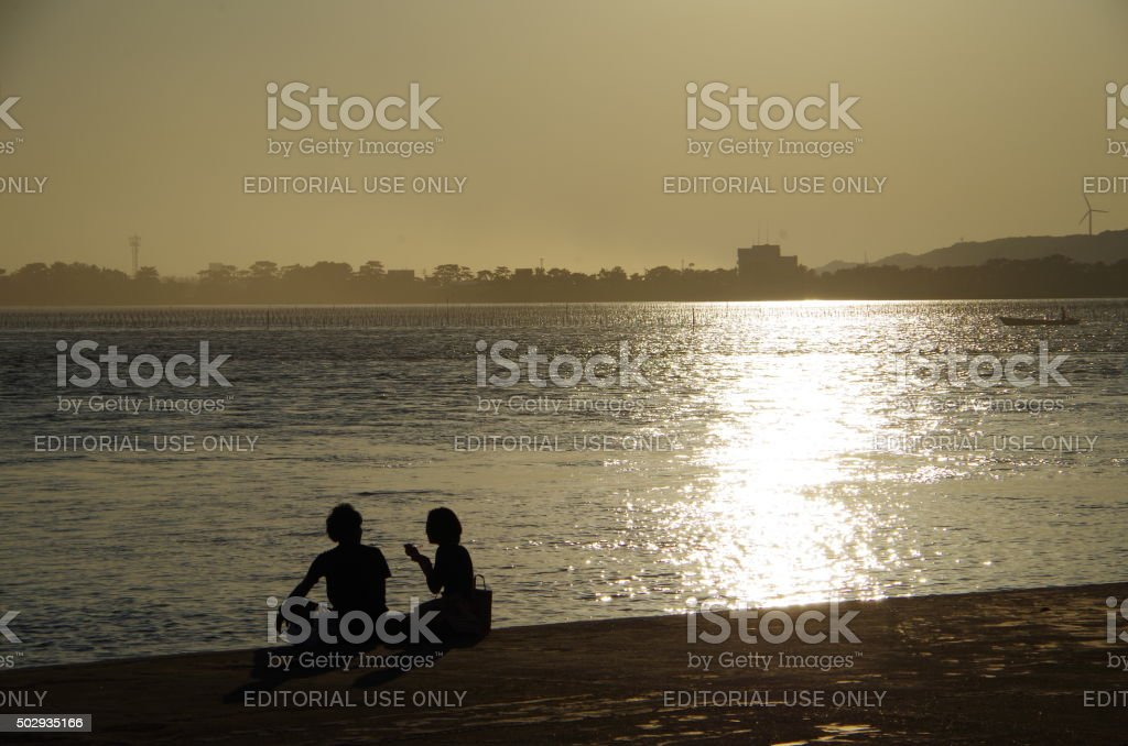 Lovers in the lakeside stock photo
