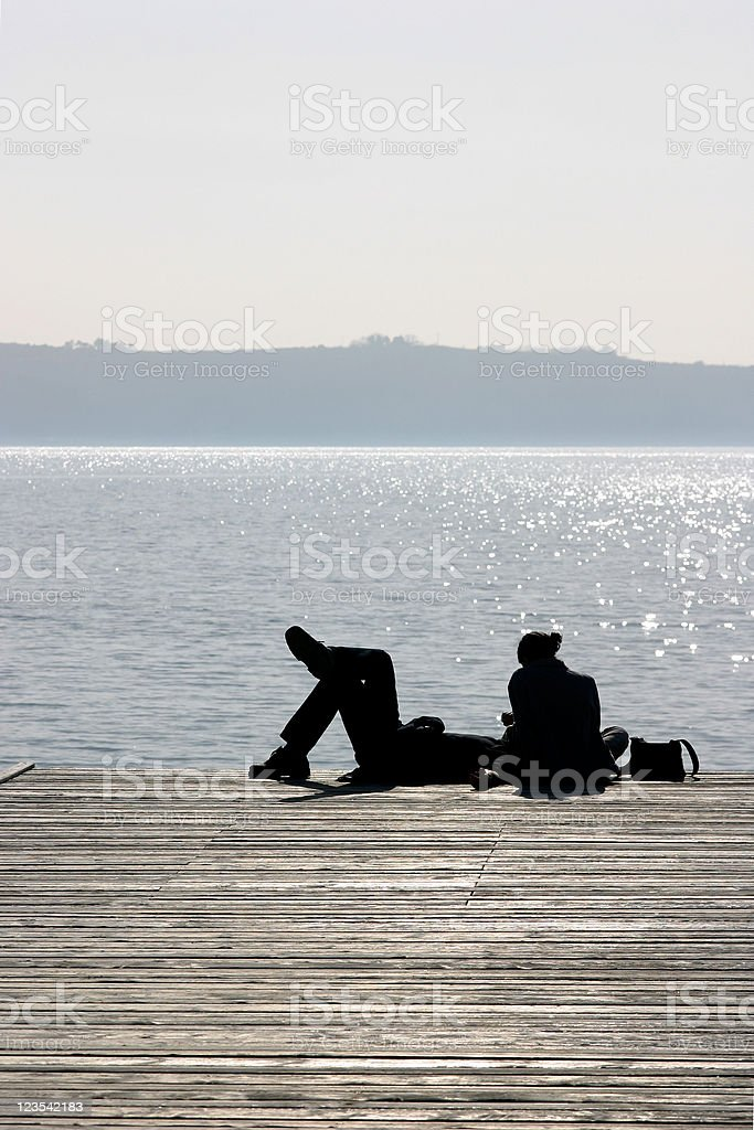 Lovers on pier royalty-free stock photo