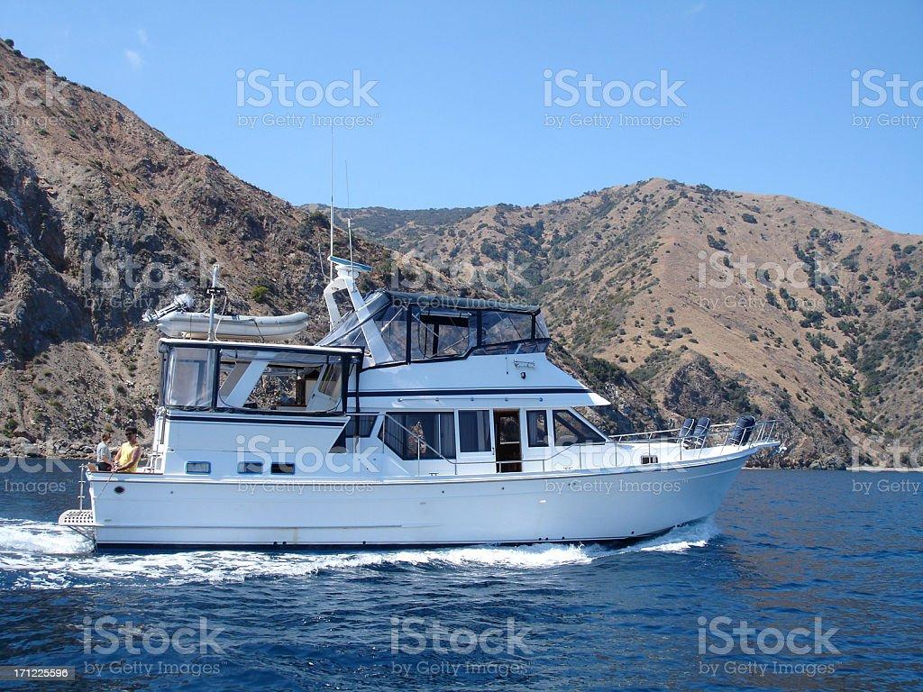Lovers on Trawler Nautical Vessel Yacht to Paradise Heterosexual Couple stock photo