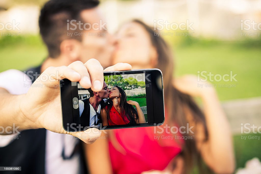 Lovers photographing themselves royalty-free stock photo