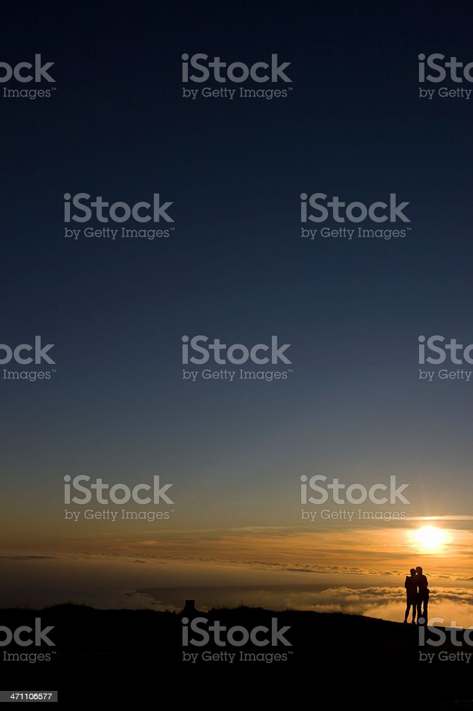 Lovers under beautiful sunset royalty-free stock photo