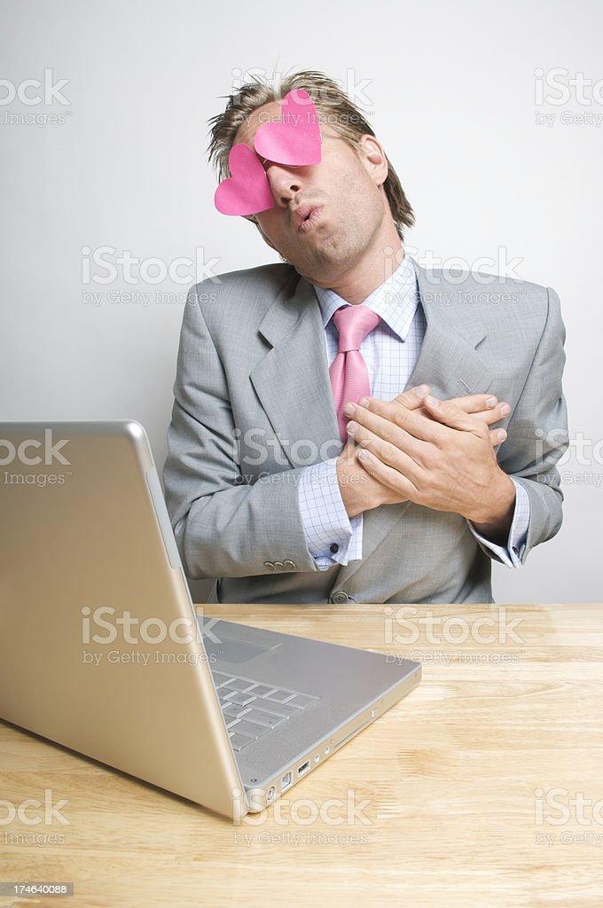 Lovestruck Businessman Holds Heart stock photo