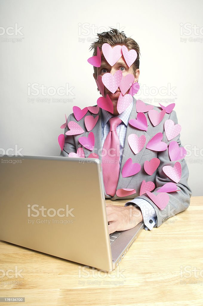 Lovestruck Office Worker Looks Surprised at Computer stock photo