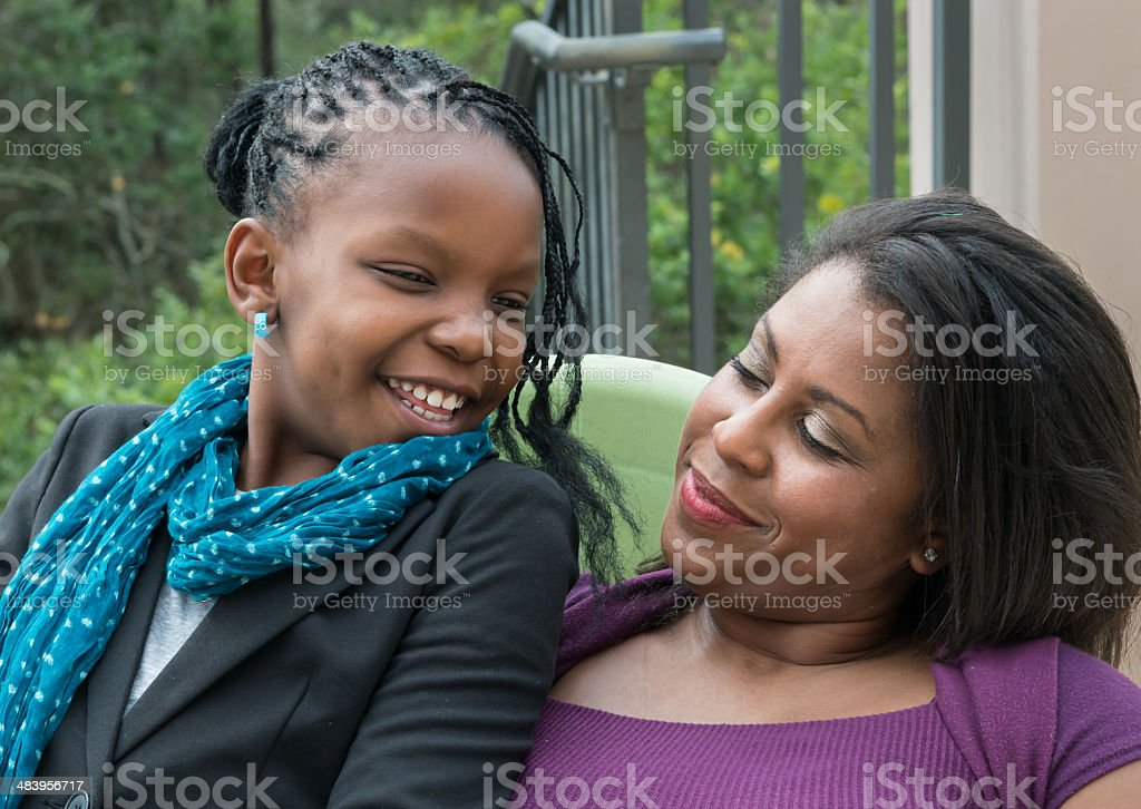 Loving African-American mother and daughter stock photo