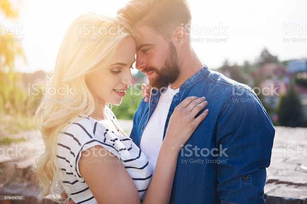 Loving and full of passion couple at sunset stock photo