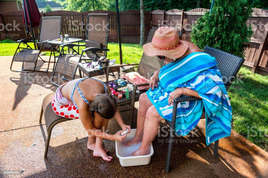Loving care of grandma's feet stock photo