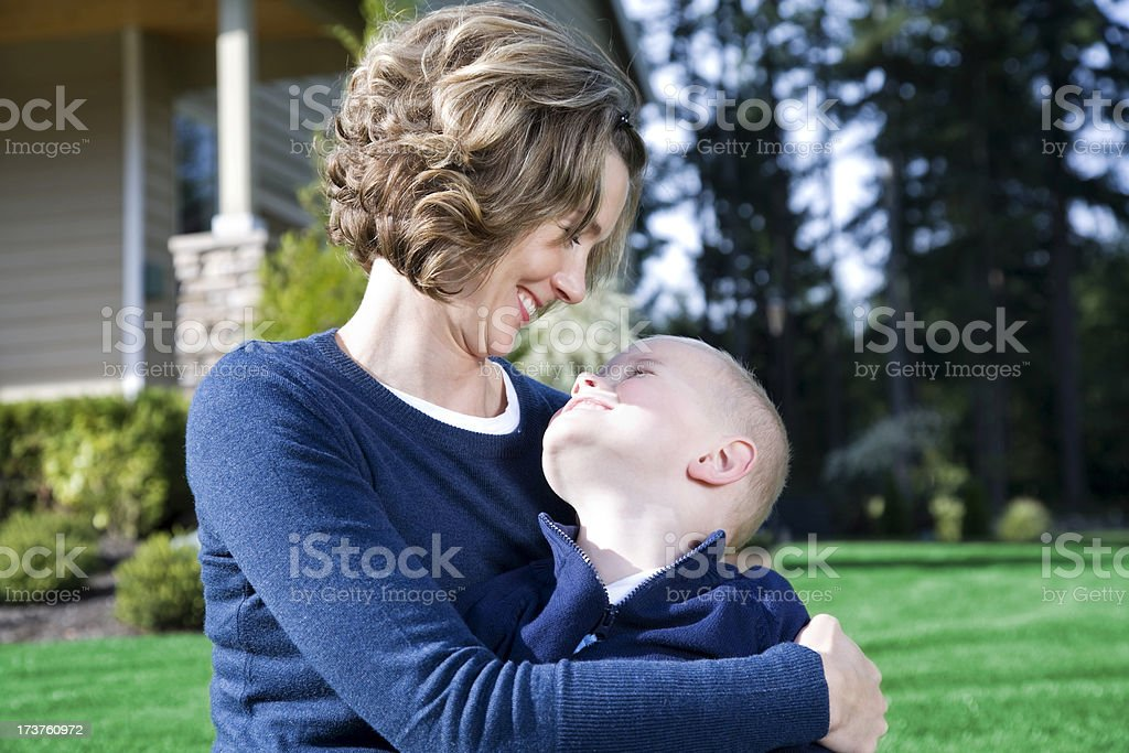 loving connection between a mother and son home outdoors royalty-free stock photo