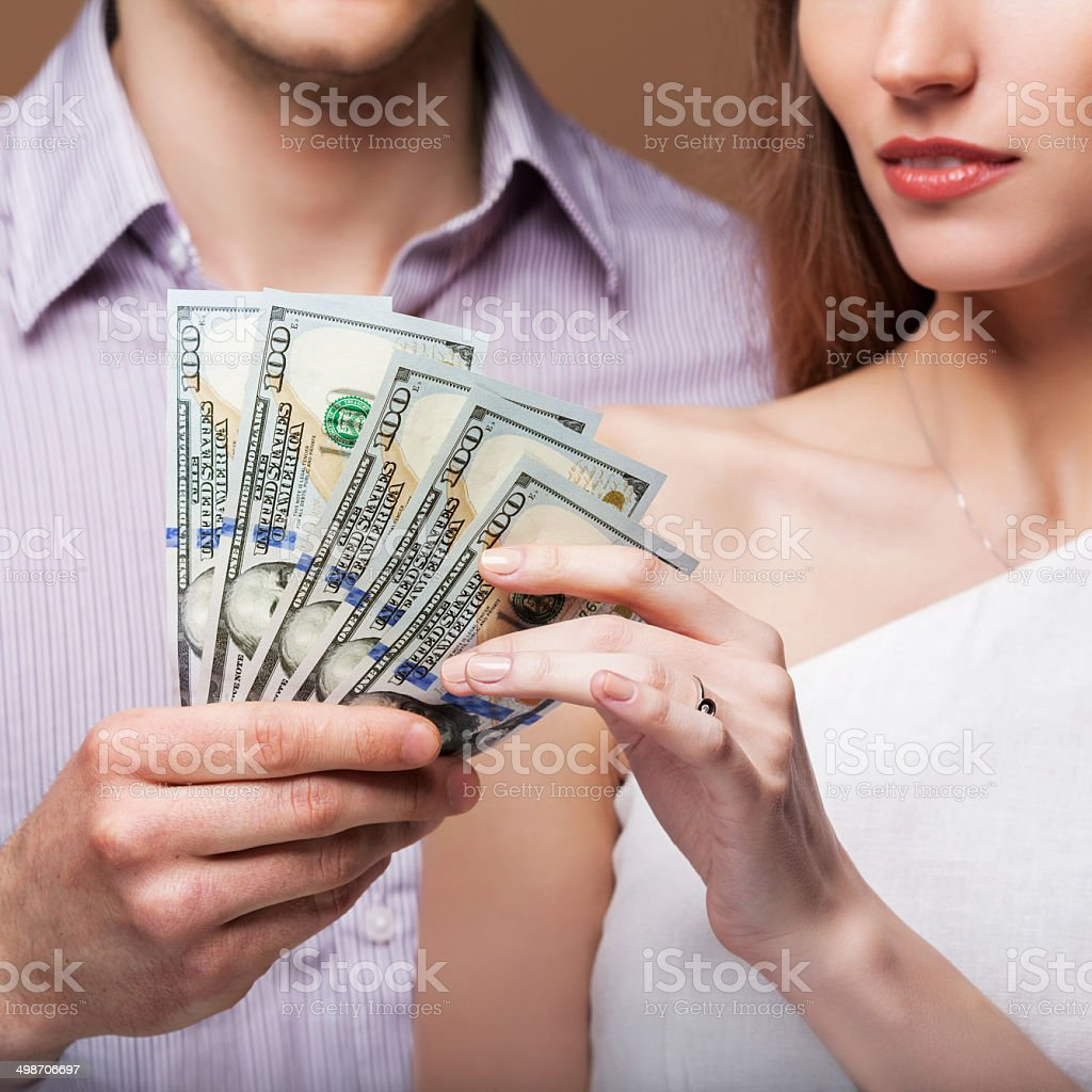 Loving couple are holding a large sum of money. royalty-free stock photo