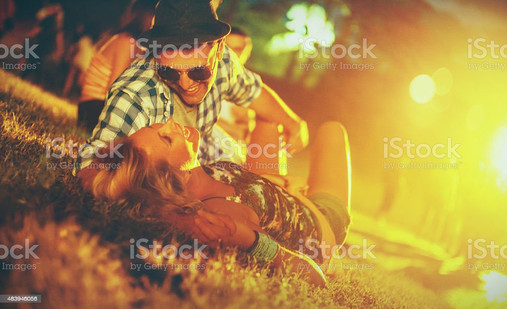Loving couple at music festival. stock photo
